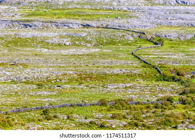 Rocks and stone wall over mountain in Burren way trail, Ballyvaughan, Clare, Ireland