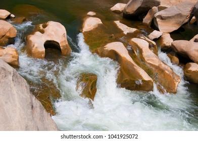 Rocks in stream flowing water