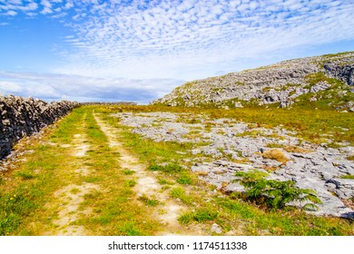 Rocks and trail over mountain in Burren way trail, Ballyvaughan, Clare, Ireland