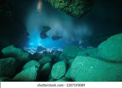 Rocks underwater inside a shallow cave in the Mediterranean sea, natural light, Costa Brava, Spain