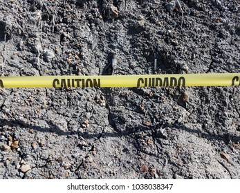 rocks of various sizes and a slope with yellow caution tape