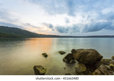Rocks and water at the Apoyo Lagoon during sunrise