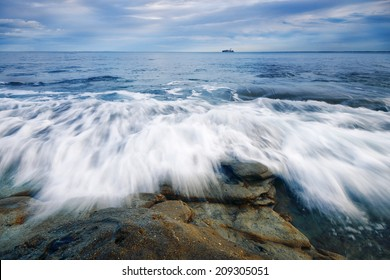 Rocks and waves at Kings Beach - Sunshine Coast, QLD.