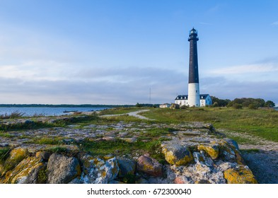 Rocks and a winding path leading to the Sorve Lighthouse in Saaremaa, Estonia