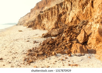 Rockslide. Mountain landslide in an environmentally hazardous area. Large cracks in earth, descent of large layers of earth blocking road. Mortal danger of dam at foot of landslide slopes of mountain