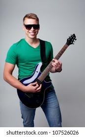 Rockstar  man playing on electric guitar