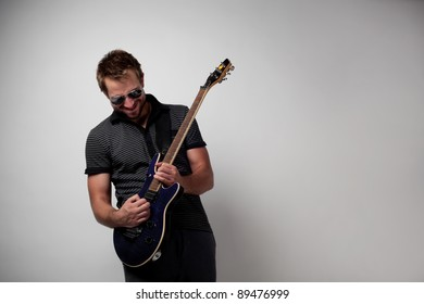 Rockstar playing solo on guitar.