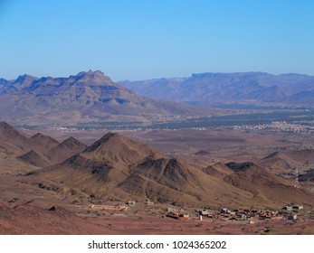 Rocky Atlas Mountains range landscapes in southeastern Morocco near old village of Oulad and clear blue sky in 2017 warm sunny winter day, northern Africa on February.