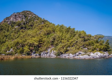 Rocky bank of River Dalyan between Dalyan village and Iztuzu Beach in Mugla Province of Turkey