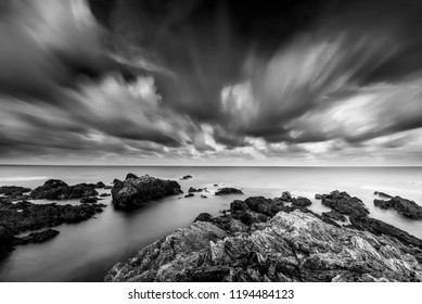 rocky beach in black and white. long exposure effect.