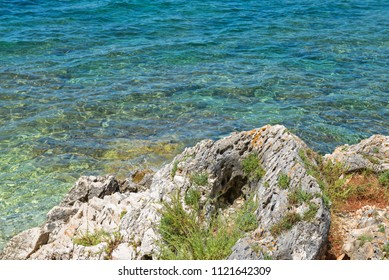 Rocky beach, bue transperent, sea and islands in Istria, Croatian coast