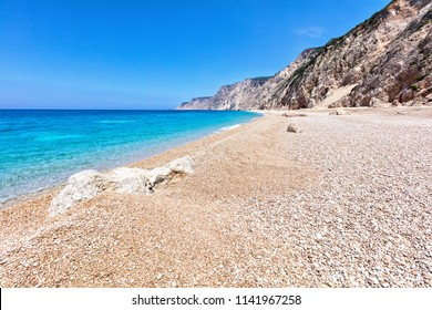 Rocky beach by a turquoise water