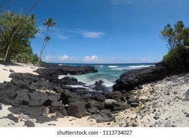 Rocky beach with clear sea water at Lefaga, Matautu, Upolu Island, Western Samoa, South Pacific