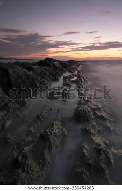 Rocky beach during sunset