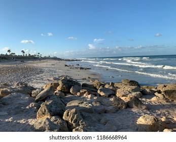 Rocky beach in Florida at sunset.