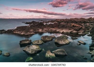 Rocky beach landscape by Arild, Sweden.