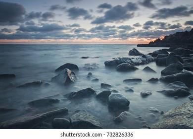 Rocky beach landscape at dusk. Kullaberg, Sweden.