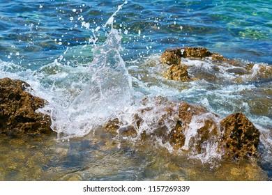 rocky beach on the coast of Porec in Croatia