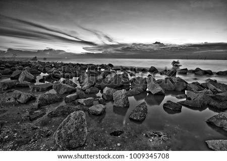 Rocky Beach At Sunset In Black And White Photography
