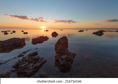 Rocky beach at sunset with vibrant colors
