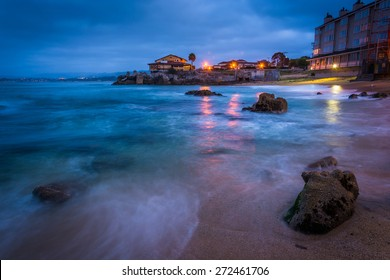Rocky beach at twilight, in Monterey, California.