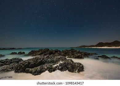 A rocky beach view under the stars in Musairah Island.