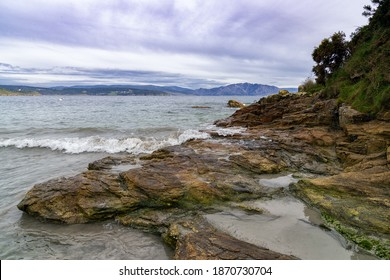 A rocky beach with waves breaking on the western coast of Galicia
