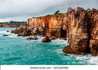 Rocky cave and Atlantic Ocean coastline. Amazing view at Boca do Inferno, Hell's Mouth, Cascais, Portugal