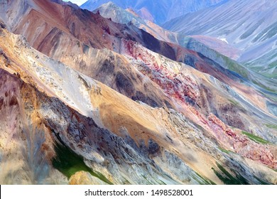 Rocky cliffs above the Kaskawulsh River in Kluane National Park, Yukon, Canada