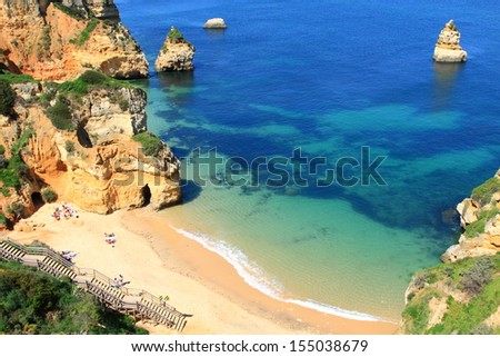 Rocky cliffs on the coast of the Atlantic ocean in Lagos, Algarve, Portugal