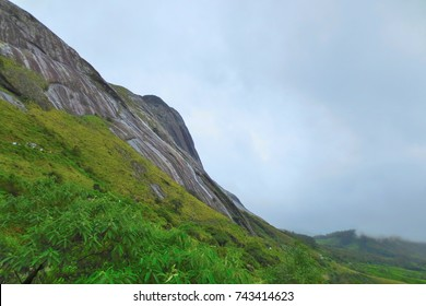 Rocky cliffs on the high mountain of Munnar, India.