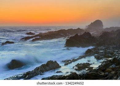 Rocky coast after sunset in Tsitsikama national park, south africa