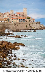 Rocky coast of Antibes, France. French Riviera. Cote d Azur. Clear blue sea. Europe.