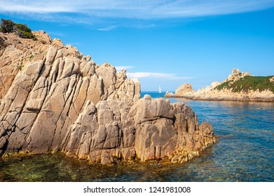 Rocky coast at the Cap Camarat with the island Rocher des Portes in the Department Var of the province Provence-Alpes-Cote d Azur