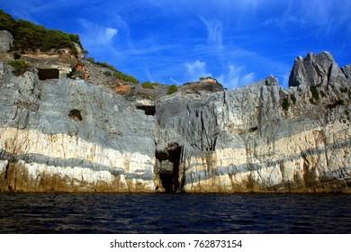 Rocky coast with cave of Palmaria island
