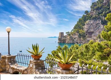 Rocky coast, clear azure sea near Positano on Amalfi Coast in Campania, Italy. Amalfi coast is popular travel and holyday destination in Europe.