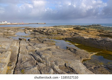 Rocky coast of Guilvinec or Le Guilvinec, a commune in the Finistère department of Brittany in north-western France