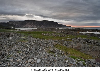 Rocky coast with mountains in Northern Norway