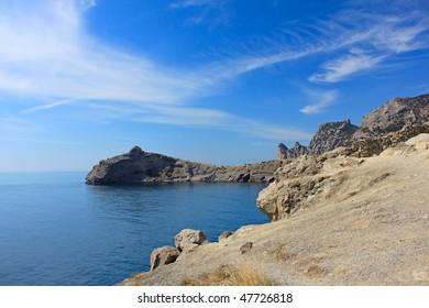 Rocky coast on a background of the blue sky