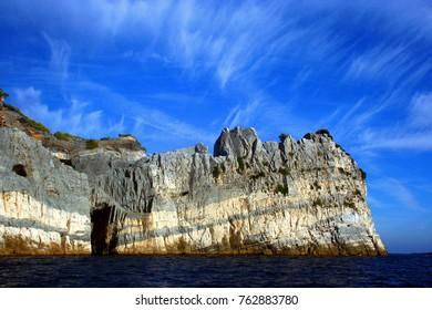 Rocky coast with Palmaria island cave
