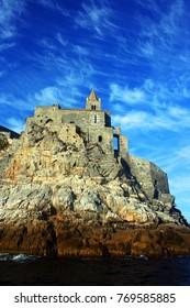 Rocky coast of Portovenere with atop church of San Pietro