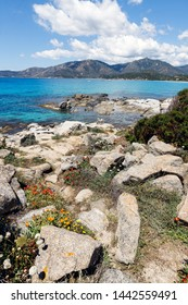 Rocky coast and sea with azure turquoise crystal clear water on the beach in Villasimius, Sardinia (Sardegna) island, Italy. Vertical landscape. Holidays, the best beaches in Sardinia.