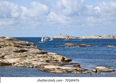 Rocky coast and sea View with sail boats at sea