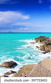 Rocky coast of Sicily with islands far away