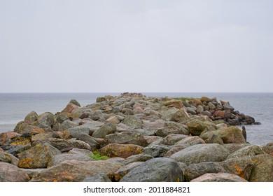 Rocky coastal landscape scene at shore of ocean. High quality photo