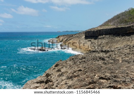 rocky coastline and atlantic ocean of punta marillos arecibo puerto rico
