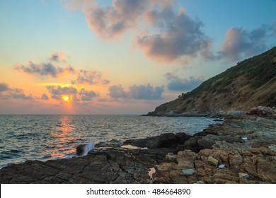 Rocky coastline during sunset at Rayong province, Thailand.