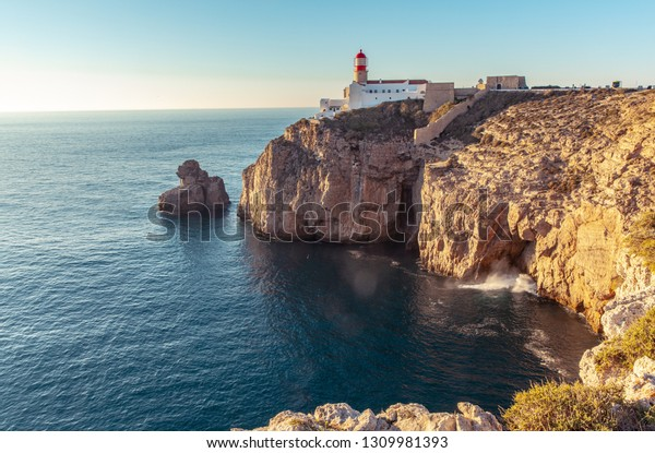Rocky Coastline and Lghthouse cape sao Vicente in Sagres Algarve Portugal
