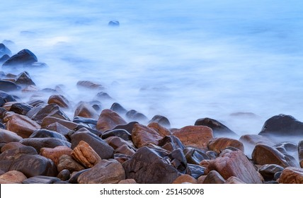 Rocky coastline with misty water.  Shot as a Long exposure