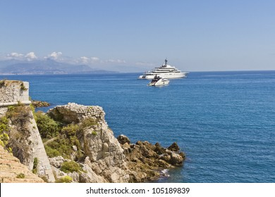 Rocky coastline on the Mediterranean Sea of Antibes. Antibes is a resort town in the Alps-Maritimes department in southeastern France between Cannes and Nice, Cote d'Azur.